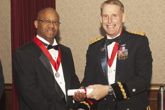 Etheridge accepts award