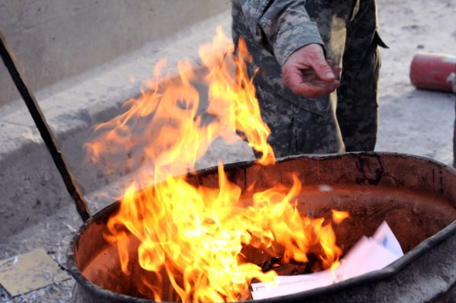BAGHDAD - Fire can be used to dispose of documents instead of simply throwing them into the trash.