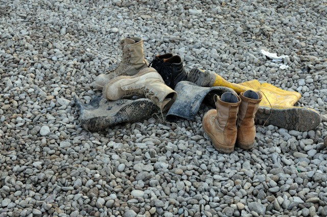 BAGHDAD - Discarded boots are just one of the items that should not be thrown into the trash for operational security reasons. Uniform materials should be incinerated to keep them from potentially being used by unauthorized personnel.
