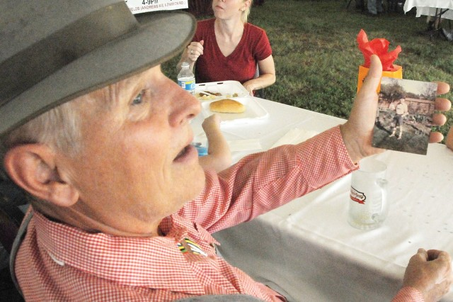 While attending Fort Rucker's Oktoberfest Sept. 25, Bill Voth, of Enterprise, shows a photograph of his father wearing lederhosen he wore to Germany's Oktoberfest several years ago. Photo by Jeremy Wise