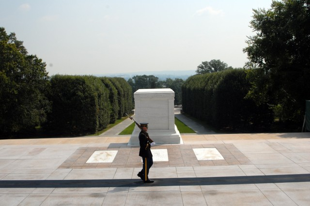 A Tomb Sentinel walks in front of the Tomb of the Unknown Soldier at Arlington National Cemetery.  The Tomb of the Unknowns Soldier has been guarded non-stop by Soldiers of the 3rd U.S. Infantry Regiment (The Old Guard) since 1948.
