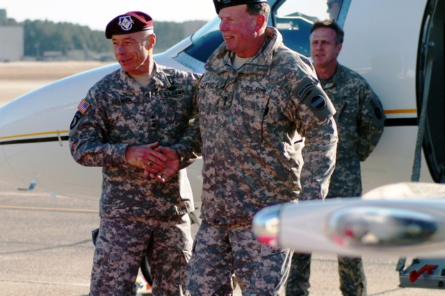 Lt. Gen. Frank Helmick, left, commander of the XVIII Airborne Corps, greets Forces Command commander, Gen. Charles Campbell, during a visit to Fort Bragg to meet with Soldiers and key leaders of the XVIII ABN Corps, Jan 6.