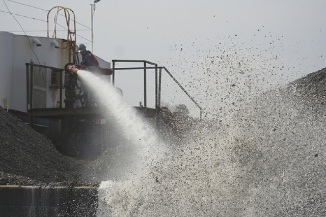 Contractors working for the U.S. Army Corps of Engineers Norfolk District use high-pressure water cannons to spread oyster shell in the Lynnhaven River in Virginia Beach, Va., in an effort to build medium-relief oyster reefs for an ongoing oyster restoration project.
