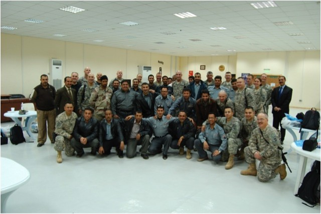 Members of C 1-3 and 211MP BN gather on Dec 26th 2009 for a meet and greet session with the Iraqi Correctional Officers that they will train up over the next couple months to take control of the TAJI TIFRC.