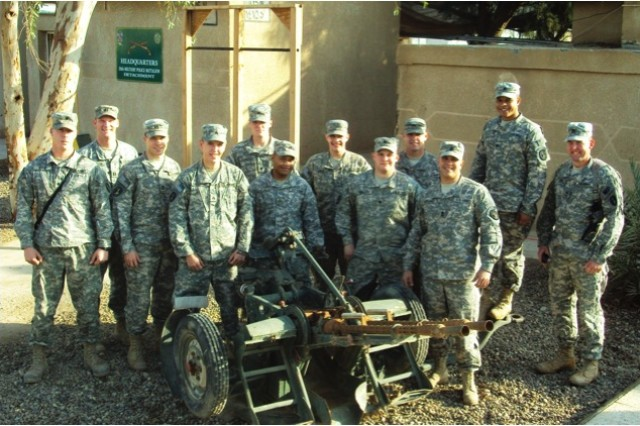 """Headquarters PLT with the Command Team pose for a group photo outside the Company Tactical Operations Center on New Years Day."""""""