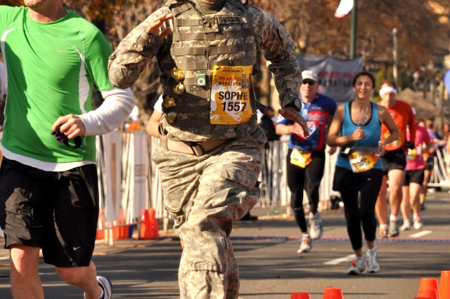 2nd Lt. Sophie Hilaire sprints to the finish of the Philadelphia Marathon, setting a Guinness World Record for women by running the Nov. 22 race in 4 hours 54 minutes wearing full battle rattle.