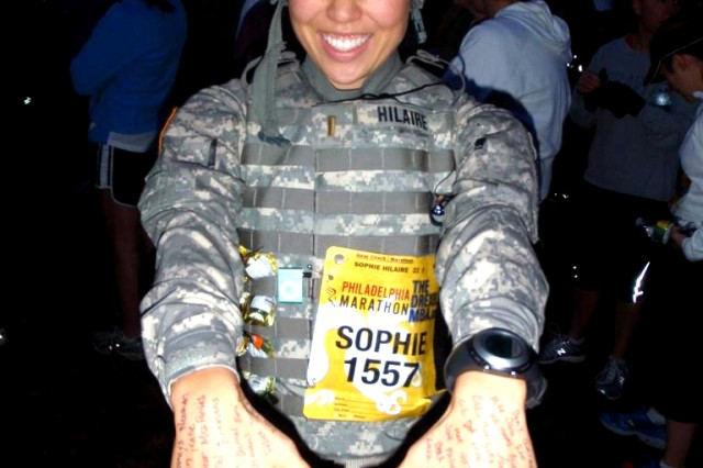 2nd Lt. Sophie Hilaire displays the signatures of well wishers on her hands prior to the start of the Philadelphia Marathon.