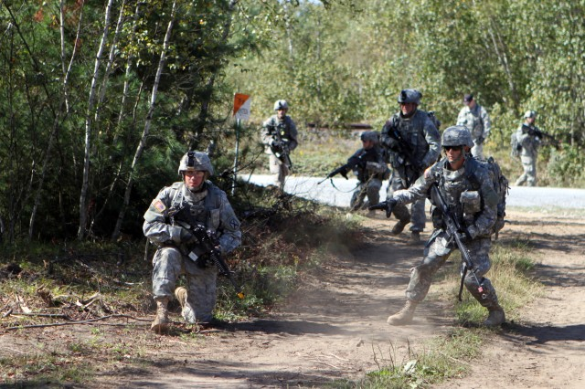 Soldiers in the Warrior Leader Course practice battle tactics in the field.