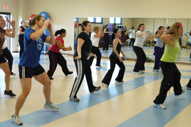 Angelica Robinson, green shirt, leads a Zumba class at the Pine Plains Physical Fitness Center.
