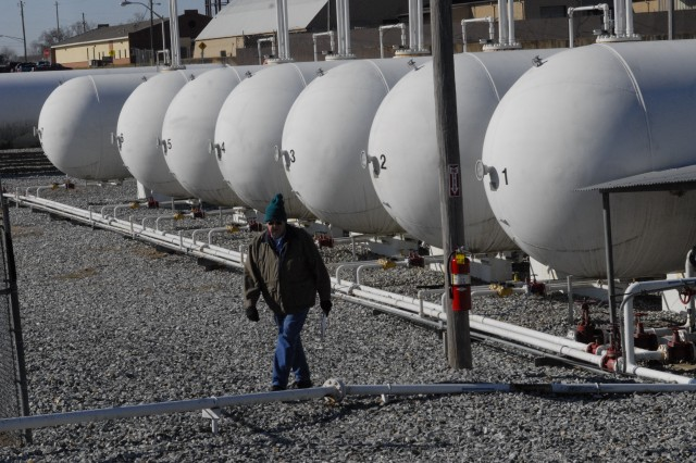 Mickey Edwards, an electronics technician with Shaw, checks on some of the 30,000-gallon propane tanks Tuesday at Fort Benning's peak shaving plant.