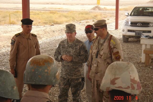 Brig. Gen. Chris Tucker, USASAC commander, speaks to Iraqi Army trainees at the Besmaya Training Center.