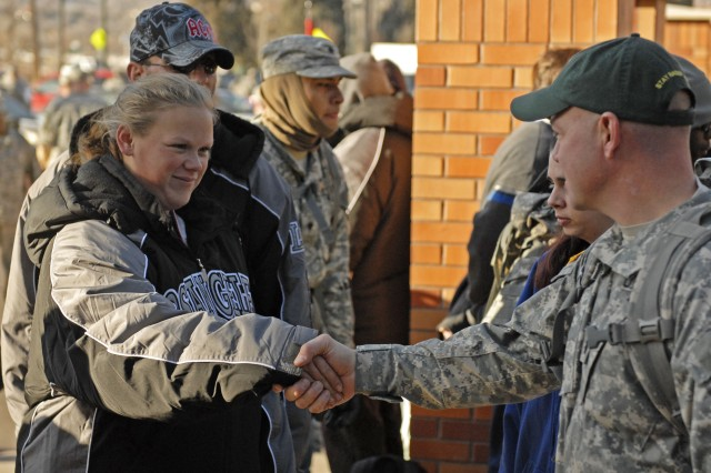 "COLORADO SPRINGS, Colo. - A homeless woman gives thanks and a hand shake to Lt. Col. Brandon Newton, deputy commanding officer, 1st Brigade Combat Team, 4th Infantry Division, during ""Operation: Happy Christmas"" Dec 18. Newton led a group of nearly 300 ""Raider"" Brigade Soldiers on a two and a half mile foot march to deliver camping supplies and warm weather gear to the homeless of Colorado Springs."