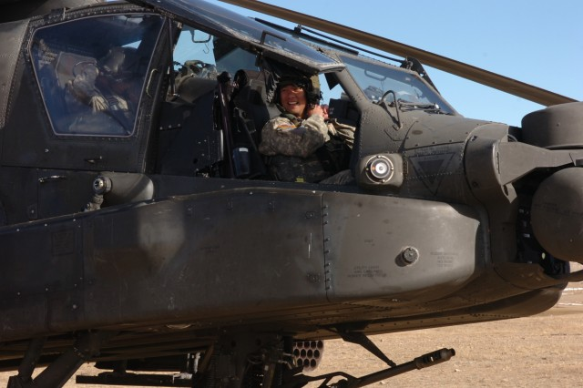 FORT CARSON, Colo. - Maj. Eddie Lee, battalion operations officer, 1st Battalion, 2nd Aviation Regiment, 2nd Infantry Division, performs his pre-flight checks before qualifying with his AH-64D Longbow Apache Helicopter during live-fire qualifications at Fort Carson Aerial Gunnery Range 109 Dec. 13.