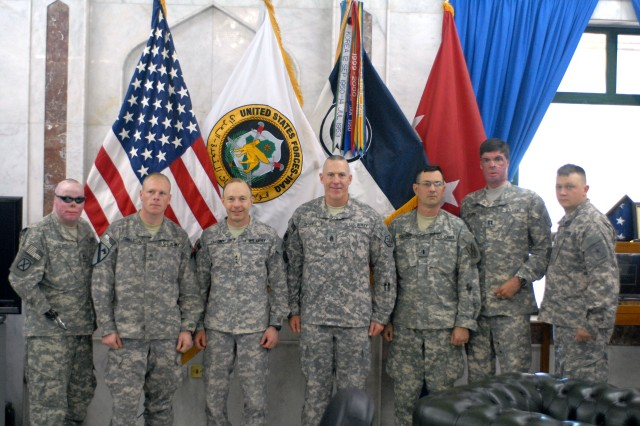 (left to right) Sgt. 1st Class Mike Schlitz; Sgt. Bill Congleton; Lt. Gen. Charles H. Jacoby, Jr., I Corps commanding general and United States Forces-Iraq deputy commanding general of operations; Command Sgt. Maj. Frank Grippe, I Corps command sergeant major; 1st Lt. Jim Kirchner; Capt. Sam Brown and Sgt. 1st Class Joshua Olson pose for a photo in Jacoby's office Jan. 1, at Camp Victory in Baghdad. Jacoby spoke with the Soldiers about the positive effects Operation Proper Exit has had on their ability to gain closure after their injuries.