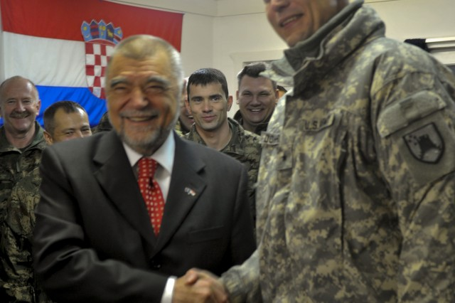 Stjepan Mesic, president of Croatia, and Brig. Gen. Al Dohrmann, commander, Multi-National Task Force - East, pose for a few photos while at Camp Bondsteel, Kosovo, Jan. 8, 2010.  Mesic visited Camp Bondsteel to listen to a brief about the future of his Soldiers deployed for KFOR and to also tour Camp Bondsteel.