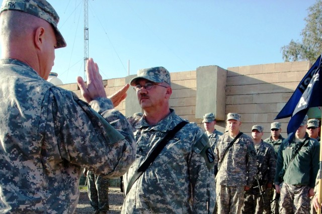CONTINGENCY OPERATING LOCATION Q-WEST, Iraq - Capt. Drew Clark, a company commander from Madison, Miss., returns the salute of newly promoted Sgt. Russell R. Rippy, assistant sergeant of the guard for the North Entry Control Point, during a promotion ceremony in the company area at Contingency Operating Location Q-West, Jan. 5. Rippy serves with A Company, 2nd Battalion, 198th Combined Arms, 155th Brigade Combat Team, out of Hernando, Miss.