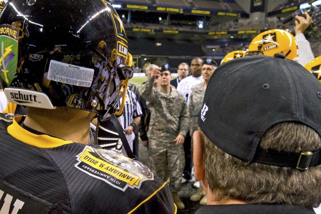 Spc. Hutchinson flips the coin to determine which team kicks off to start the 2010 All-American Bowl high school all-star football contest in the Alamodome in San Antonio, Texas.