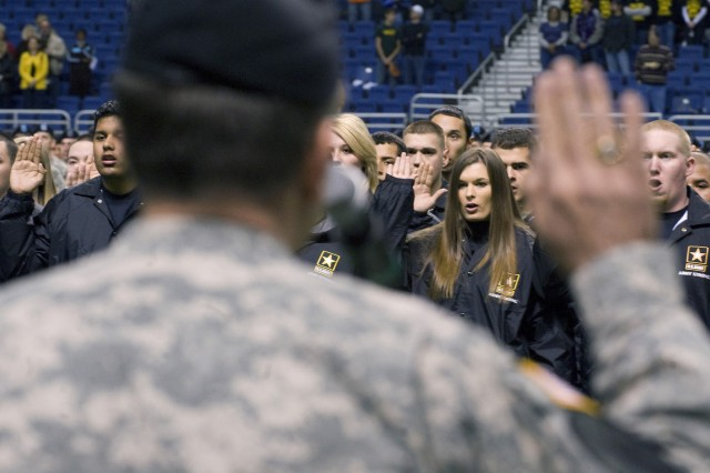 Army Vice Chief of Staff Gen. Peter W. Chiarelli swears in delayed entry recruits during pre-game activities prior to the start of the 10th Army-sponsored All-American Bowl high school all-star football game at the Alamodome in San Antonio, Texas, on Jan. 9.