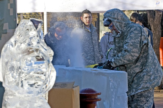 Chief Warrant Officer Robert Marsh begins an ice sculpture to show the crowds at the Army Strong Zone outside the Alamodome in San Antonio, Texas. The display was one of dozens set up for fans prior to the start of the Army-sponsored All-American Bowl.
