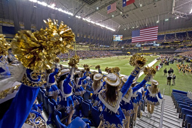 A high school drill team rallies their team at the start of the Army-sponsored All-American Bowl high school all-star football game held in the Alamodome in front of an audience of 34,126.