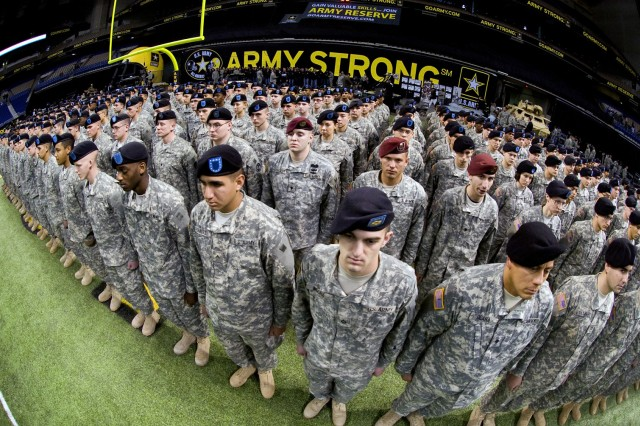 Medical AIT students from Fort Sam Houston in San Antonio take part in pre-game ceremonies before the kick-off of the 10th Army-sponsored All-American Bowl high school all-star football contest.