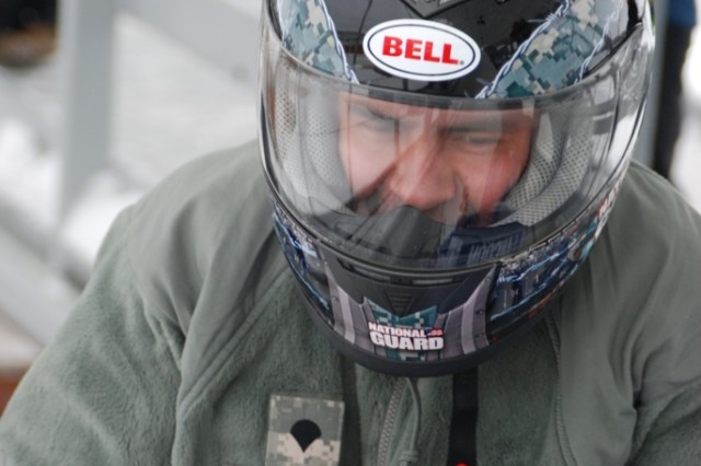 LAKE PLACID, NY--New York Army National Guard Specialist Michael Graham, from Plattsburgh, NY, makes ready to tackle the Mt. Van Hoevenberg bobsled run on Sunday, Jan 10, during the 5th Annual Lucas Oil Bodine Bobsled Challenge here. The event, held to raise money for the U.S. Olympic Team, paired professional race car drivers with members of Company B 2nd Battalion 108th Infantry. The Soldiers served as brakemen on the sleds. This is the third year that New York Army National Guard Soldiers have been teamed with NASCAR and NHRA drivers in the event