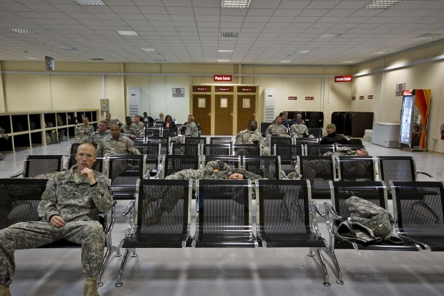 CAMP TAJI, Iraq - With the opening of the new passenger terminal Jan. 4, Soldiers have better facilities to accommodate them while they wait for a flight. The new indoor facility gives Soldiers internet access, phones, books, a large flat screen television and a warm place to sleep to help pass the time.
