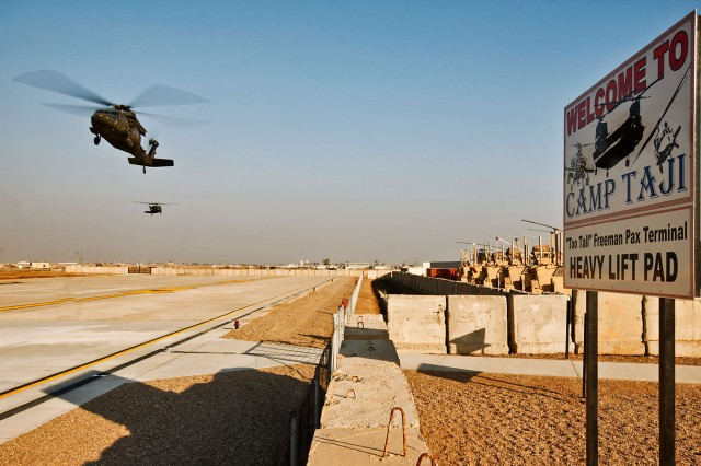 CAMP TAJI, Iraq - Two UH-60 Black Hawk helicopters from 1st Air Cavalry Brigade, 1st Cavalry Division, approach for a landing at the new passenger terminal Jan. 5.