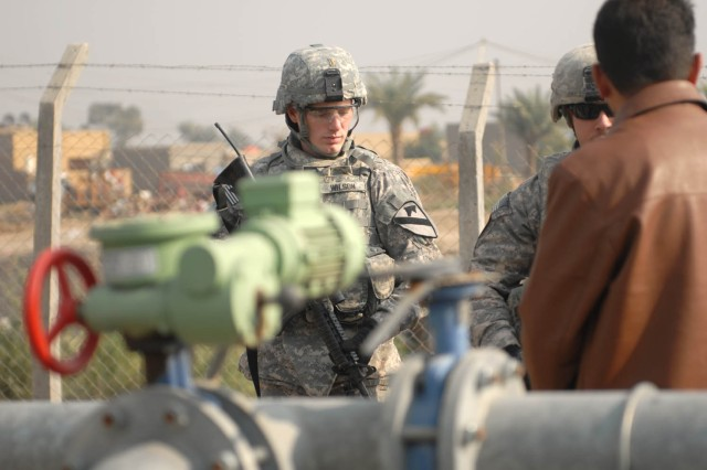 JSS ISTIQLAAL, Iraq - Huntsville, Ala., native, 2nd Lt. John Wilson, a platoon leader assigned to 1st Squadron, 7th Cavalry Regiment, 1st Brigade Combat Team, 1st Cavalry Division, visits a water purifying system outside the gates of Joint Security Station Istiqlaal Dec. 12. Soldiers from 1st Sqdn., 7th Cav. Regt., are gathering important information to complete their continuity book to pass to the incoming unit.
