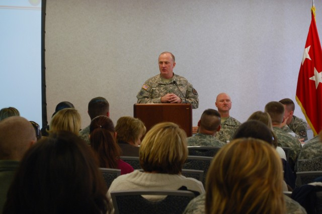 Lt. Gen. Rick Lynch, commanding general of U.S. Army IMCOM, speaks to a crowd of commanders, first sergeants, Family readiness group leaders and Family readiness support assistants and community members at Fort Riley's MUSTER meeting Jan. 8. Lynch attended the MUSTER, a child development center ribbon-cutting and the 2015 Campaign Plan brief during his visit to Fort Riley.