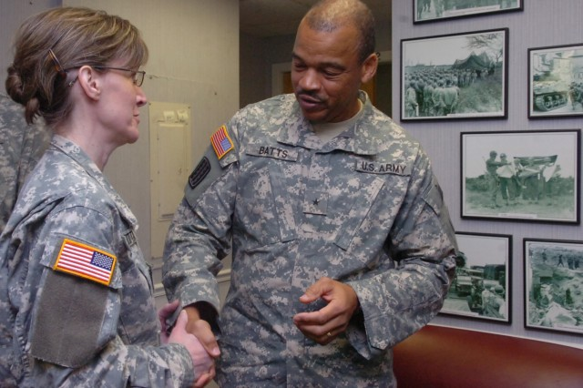 Brig. Gen. Frank E. Batts, commander, 29th Infantry Division, Virginia National Guard, receives congratulations from Col. Kim Gugliotta after his change of command ceremony Tuesday. Batts assumed command from Maj. Gen. Grant L. Hayden, who retired after more than 39 years in the Guard.