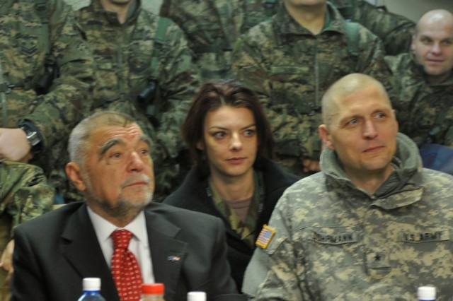 Croatian President Stjepan Mesic visits his troops at Camp Bondsteel, Kosovo, Jan. 8, and poses for a photograph with them and Brig. Gen. Al Dohrmann, commander, Multi-National Task Force - East.