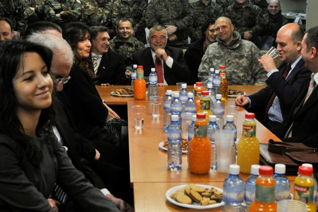 Croatian President Stjepan Mesic visits his troops at Camp Bondsteel, Kosovo, Jan. 8, while Brig. Gen. Al Dohrmann, commander, Multi-National Task Force - East, listens.
