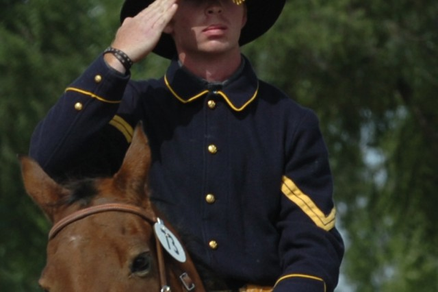 FORT ROBINSON STATE PARK, Neb. - Cpl. John Slatton, mortarman and lead rider for the Fort Carson Mounted Color Guard, assigned to Company A, Division Special Troops Battalion, 4th Infantry Division, renders a salute beginning the Military Horsemanship competition Sept. 24 during the 2009 National Cavalry Competition at Fort Robinson State Park, Neb. Military Horsemanship is like the rider putting the horse through basic training, said Joan Baird, who judged the event.
