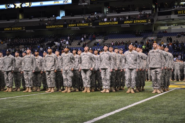 Soldier heroes are honored on field before the 2010 Army All-American Bowl in San Antonio, Texas. The group included 90 Soldiers who had earned the Silver Star, Bronze Star or Purple Heart.