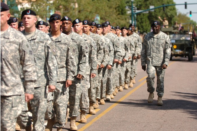 COLORADO SPRINGS, Colo. - Sgt. Richard Sanford, supply noncommissioned officer, Headquarters and Headquarters Battery, 4th Battalion, 42nd Field Artillery Regiment, 1st Brigade Combat Team, 4th Infantry Division, calls cadence for his formation marching in the Red, White and Brave Parade, Aug. 29. After the parade, Soldiers enjoyed hot dogs and ice cream during a Troop Lunch in the Park, sponsored by Colorado Springs businesses and civic organizations.