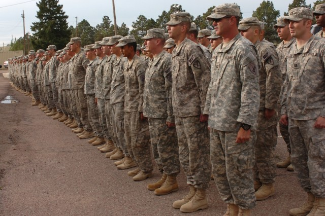 Soldiers assigned to the 110th MP Company stand outside of the Special Events Center before the welcome home ceremony began Friday August 14.