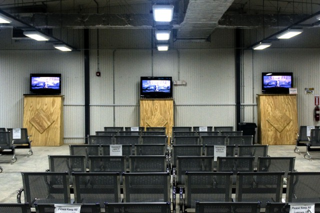 The passenger terminal at Contingency Operating Location Speicher, Iraq, which opened in November, is a hardened shelter and includes flat-screen televisions, flight information displays and more room than the previous tent terminal.