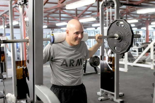 """BAGHDAD - Sgt. Jim Wendling, assigned to D Troop, Division Special Troops Battalion, 1st Cavalry Division, United States Division-Center, says he works out for one reason: survivability. """"The better shape you are in, the better chance you have of coming back from it, if you are injured,"""" said Wendling. (U.S. Army photo by Sgt. 1st Class Kristina Scott, USD-C)"""