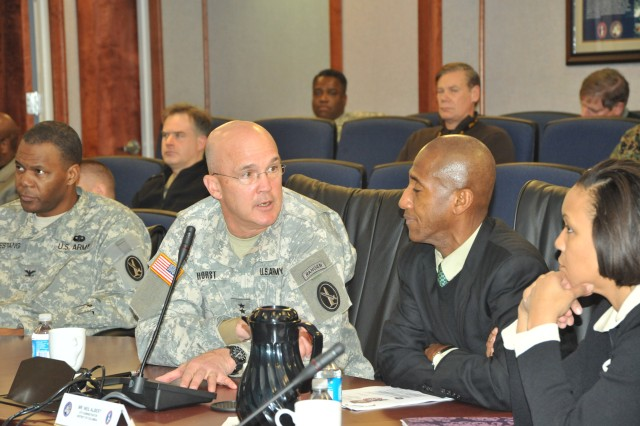 Col. Sonny Chestang (left), chief of staff, listens as Maj. Gen. Karl R. Horst (center) talks to Neil Albert, District of Columbia city administrator and Millicent Williams, director of the District of Columbia Homeland Security and Emergency Management Agency during the officials' January visit to the command.