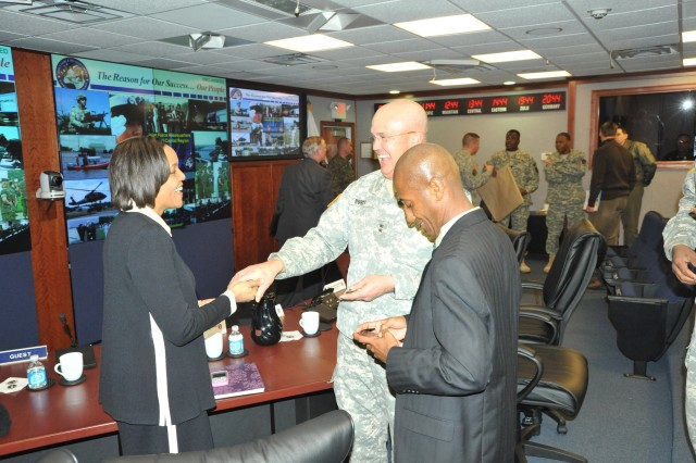 Maj. Gen. Karl R. Horst (center) presents a commander\'s coin to Millicent Williams (left) director of the District of Columbia Homeland Security and Emergency Management Agency (DCHSEMA) and Neil Albert, District of Columbia city administrator.