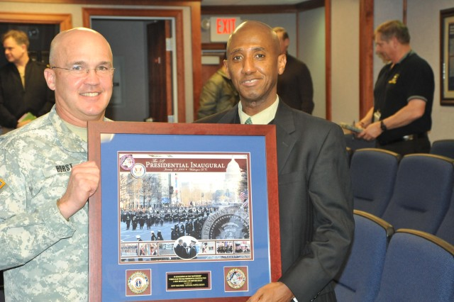 Maj. Gen. Karl R. Horst presents a 2009 Presidential Inauguration commemoration plaque to Neil Albert, District of Columbia city administrator.