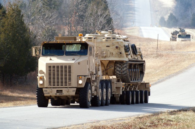 233rd Trans. Co. transports vehicles to improve ranges, gain experience