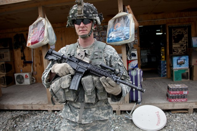 Spc. Robert Sumner, from Birmingham, England, maintains a low ready stance at Forward Operation Base Joyce in eastern Afghanistan's Kunar province, Dec. 12. Sumner is assigned to the personnel security detachment, Headquarters Company, 1st Battalion, 32nd Infantry Regiment, 3rd Brigade Combat Team, 10th Mountain Division.