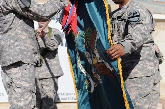 BAGHDAD - Lt. Col. Matthew Karres (left) and Command Sgt. Maj. Clinton Joseph, the senior leadership team of the 1st Cavalry Division's Special Troops Battalion, case their battalion colors in a transfer of authority and color casing and uncasing ceremony Jan. 9.