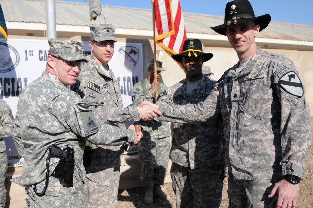 BAGHDAD - (from left) Command Sgt. Maj. Sal Katz, Lt. Col. Lane Turner, Command Sgt. Maj. Clinton Joseph, and Lt. Col. Matthew Karres, shake hands after a transfer of authority and color casing and uncasing ceremony conducted Jan. 9. Katz and Turner are the senior leadership team of the 1st Armored Division Special Troops Battalion. The two are replacing the 1st Cavalry Division Special Troops Battalion senior leadership team of Joseph and Karres.