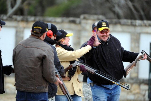San Antonio Stock Show and Rodeo Assistant Executive Director Pam Rew and SASSR volunteer Mo Parsons share a high five for their efforts on the skeet shooting range at the San Antonio Gun Club, where members of the U.S. Army Marksmanship Unit gave a demonstration and shooting lessons Jan. 7. The event preceded the U.S. Army All-American Bowl played Jan. 9 at the Alamodome.