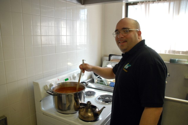 Sgt. James Soto, USAG-RC BOSS military liaison, prepares a pot of Puerto Rican chili and cornbread for BOSS members during the Warrior Country BOSS quarterly meeting in the Camp Stanley CAC, March 6.
