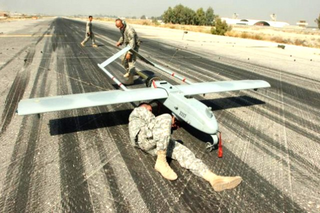 Army Sgts. Jeremy R. Squires, Ronald F. Williams and Anh M. Huynh attend to a Shadow unmanned aerial vehicle at Forward Operating Base Fenty on Jalalabad Airfield, Afghanistan.