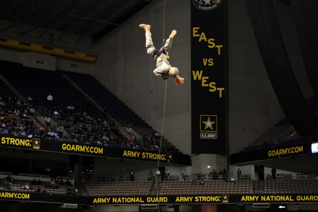A Soldier repels from the Alamodome rafters to deliver the game ball for the 10th annual U.S. Army All-American Bowl on Jan. 9 in San Antonio. U.S.